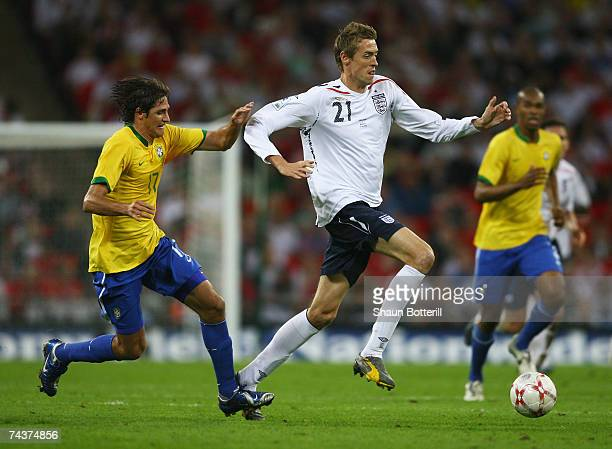 Peter Crouch of England evades Edmilson of Brazil during the International Friendly match between England and Brazil at Wembley Stadium on June 1...