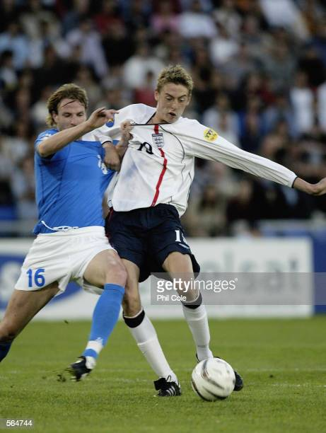 Peter Crouch of England gets tackled by M Blasi of Italy during the European Under 21's Championship Group A game between England and Italy at the St...