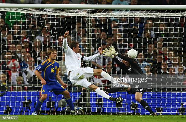 Peter Crouch of England scores the opening goal during the FIFA 2010 World Cup Group 6 Qualifying match between England and Ukraine at Wembley...