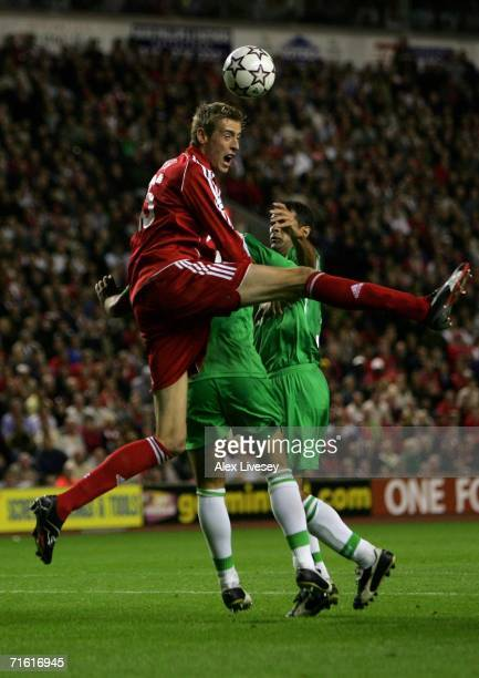 Peter Crouch of Liverpool battles for the ball in the air during the UEFA Champions League third qualifying round 1st leg match between Liverpool and...