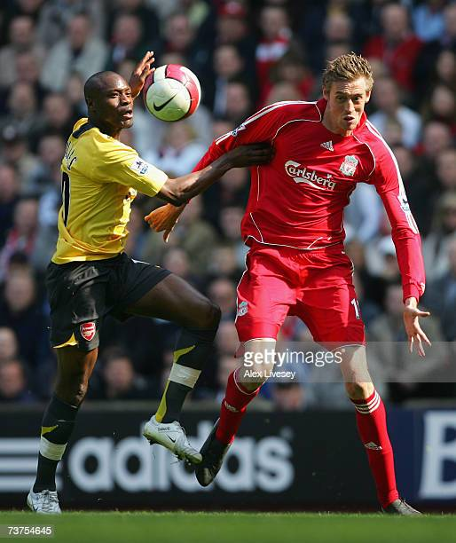 Peter Crouch of Liverpool battles for the ball with William Gallas of Arsenal during the Barclays Premiership match between Liverpool and Arsenal at...