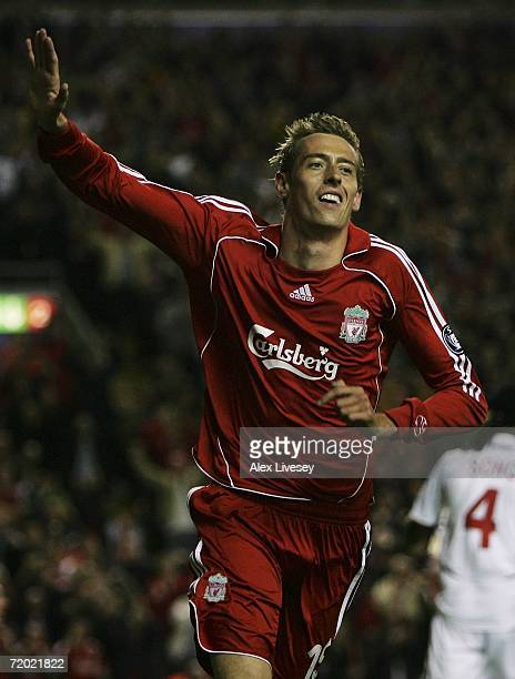 Peter Crouch of Liverpool celebrates after scoring the opening goal during the UEFA Champions League group C match between Liverpool and Galatasaray...