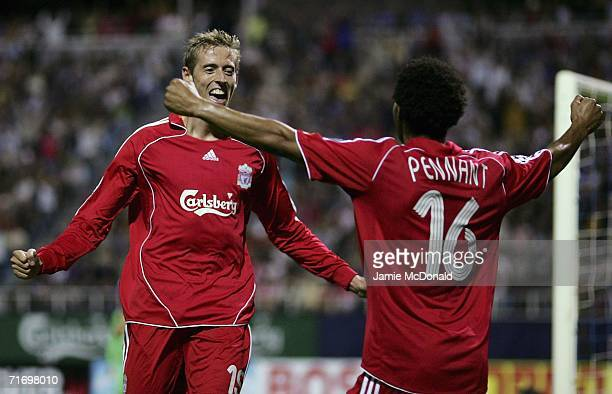 Peter Crouch of Liverpool celebrates his goal with Jermaine Pennant during the UEFA Champions League third qualifying round second leg match between...