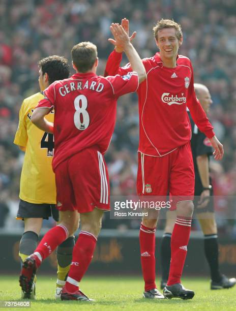 Peter Crouch of Liverpool celebrates scoring his team's second goal with team mate Steven Gerrard during the Barclays Premiership match between...