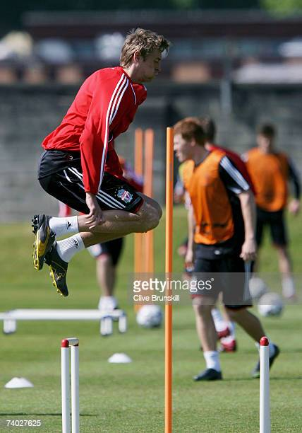 Peter Crouch of Liverpool jumps during training prior to the UEFA Champions League Semi Final second leg match between Liverpool and Chelsea at...