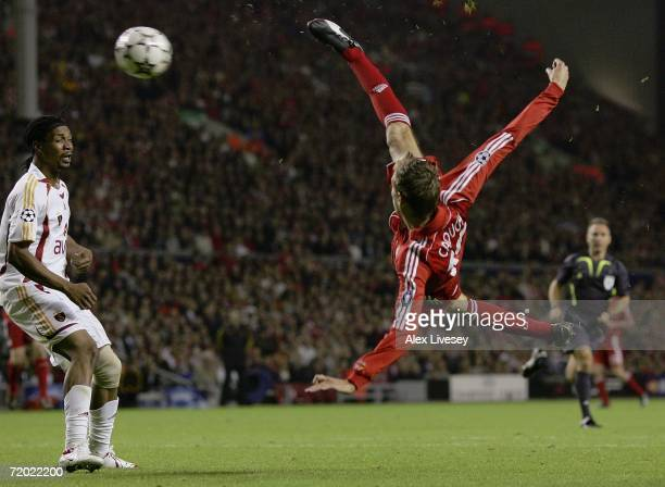 Peter Crouch of Liverpool scores his team's third goal during the UEFA Champions League group C match between Liverpool and Galatasaray at Anfield on...