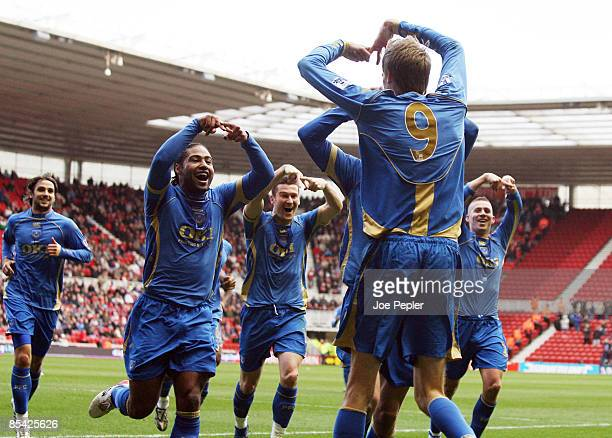 Peter Crouch of Portsmouth celebrates his goal with team mates during the Barclays Premier League match between Middlesbrough and Portsmouth at The...