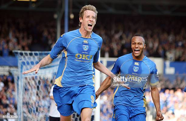 Peter Crouch of Portsmouth celebrates his second goal with Younes Kaboul during the Barclays Premier League match between Portsmouth and Everton at...