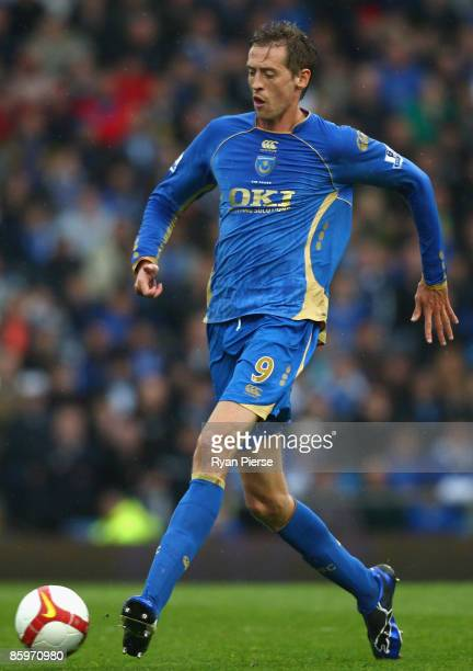 Peter Crouch of Portsmouth passes the ball during the Barclays Premier League match between Portsmouth and West Bromwich Albion at Fratton Park on...