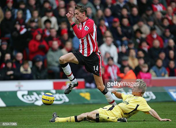 Peter Crouch of Southampton battles for the ball with Sami Hyypia of Liverpool during the Barclays Premiership match between Southampton and...