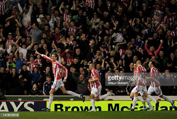 Peter Crouch of Stoke celebrates after scoring the opening goal during the Barclays Premier League match between Stoke City and Manchester City at...