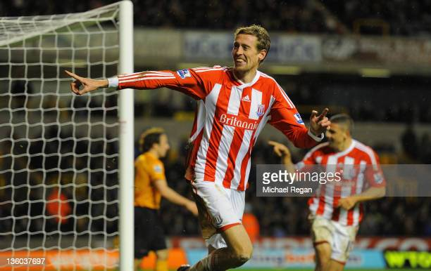 Peter Crouch of Stoke celebrates scoring to make it 21 during the Barclays Premier League match between Wolverhampton Wanderers and Stoke City at...