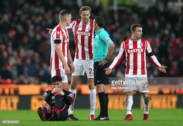 Peter Crouch of Stoke City and Ryan Shawcross of Stoke City argue with refere Michael Oliver during the Premier League match between Stoke City and...