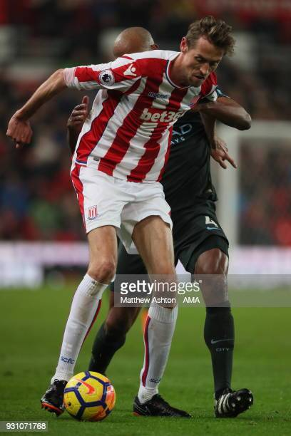 Peter Crouch of Stoke City and Vincent Kompany of Manchester City during the Premier League match between Stoke City and Manchester City at Bet365...