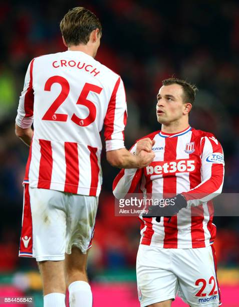 Peter Crouch of Stoke City and Xherdan Shaqiri of Stoke City celebrate victory after the Premier League match between Stoke City and Swansea City at...