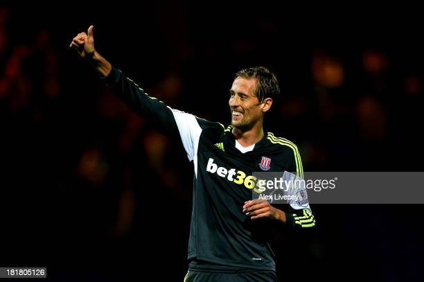 Peter Crouch of Stoke City celebrates after scoring his team's second goal during the Capital One Cup third round match between Tranmere Rovers and...