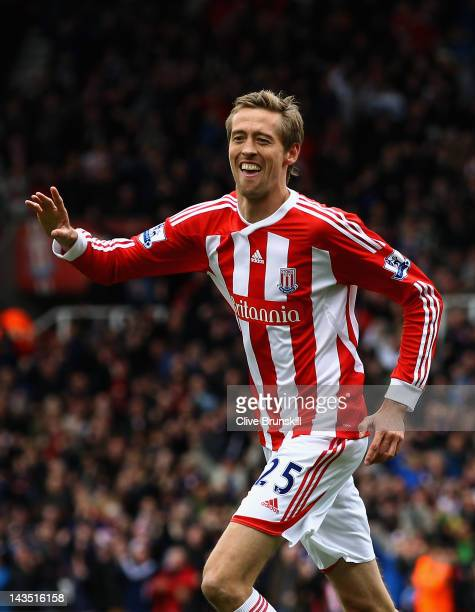Peter Crouch of Stoke City celebrates after scoring the first goal during the Barclays Premier League match between Stoke City and Arsenal at...