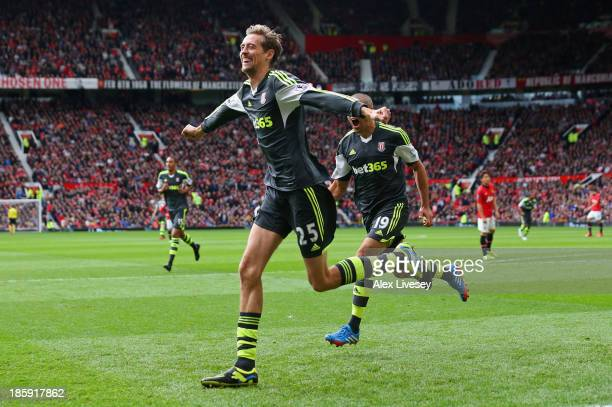 Peter Crouch of Stoke City celebrates after scoring the opening goal during the Barclays Premier League match between Manchester United and Stoke...