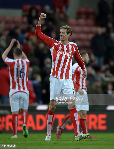Peter Crouch of Stoke City celebrates at the end of the Barclays Premier League match between Stoke City and Hull City at Britannia Stadium on...