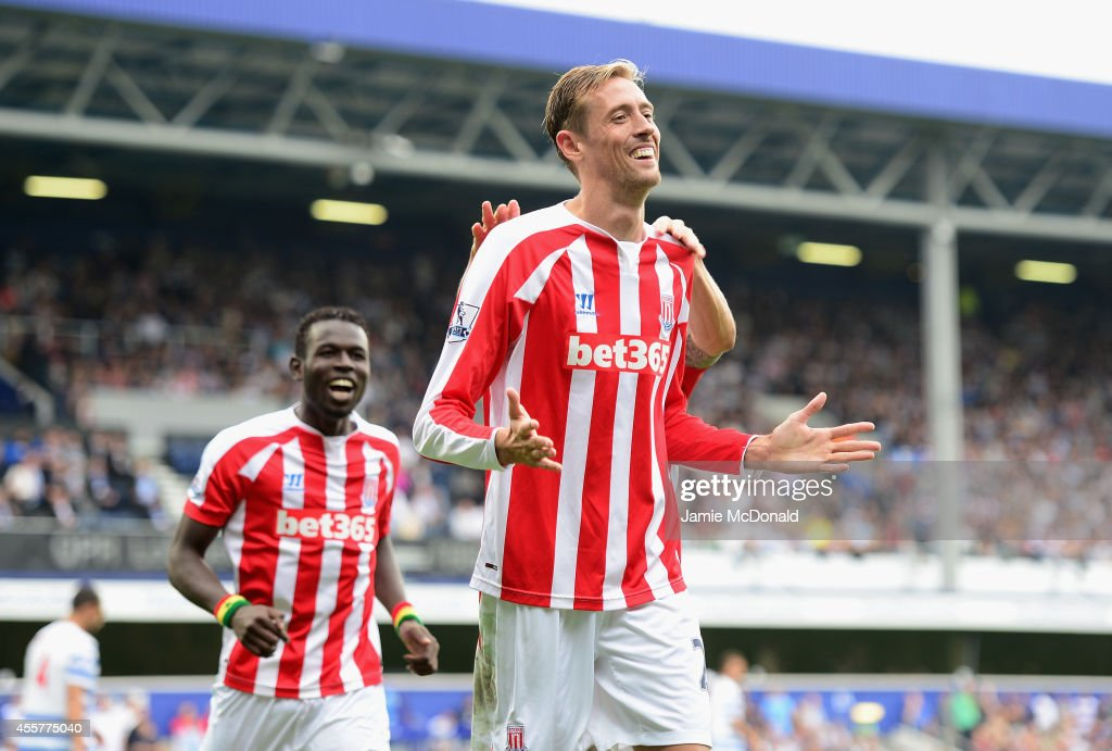 Peter Crouch of Stoke City celebrates his goal during the Barclays Premier League match between Queens Park Rangers and Stoke City at Loftus Road on September 20, 2014 in London, England.