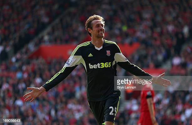 Peter Crouch of Stoke City celebrates scoring during the Barclays Premier League match between Southampton and Stoke City at St Mary's Stadium on May...