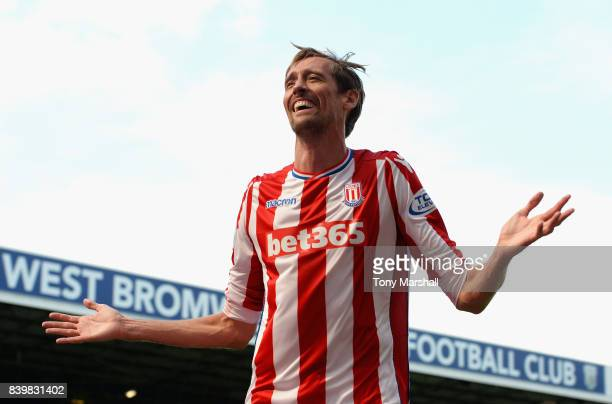 Peter Crouch of Stoke City celebrates scoring his sides first goal during the Premier League match between West Bromwich Albion and Stoke City at The...