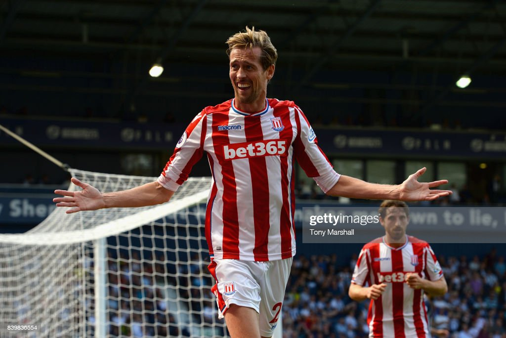Peter Crouch of Stoke City celebrates scoring his sides first goal during the Premier League match between West Bromwich Albion and Stoke City at The Hawthorns on August 27, 2017 in West Bromwich, England.