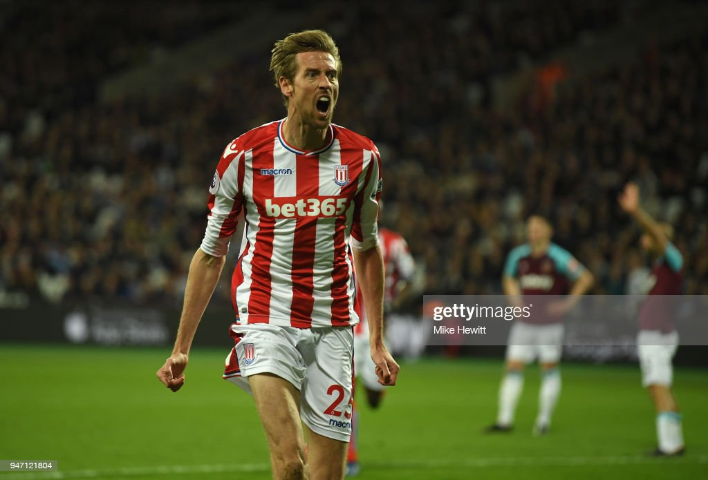 Peter Crouch of Stoke City celebrates scoring his sides first goal during the Premier League match between West Ham United and Stoke City at London Stadium on April 16, 2018 in London, England.