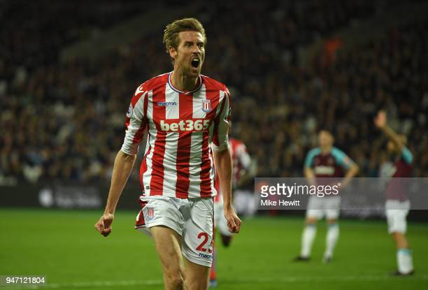 Peter Crouch of Stoke City celebrates scoring his sides first goal during the Premier League match between West Ham United and Stoke City at London...