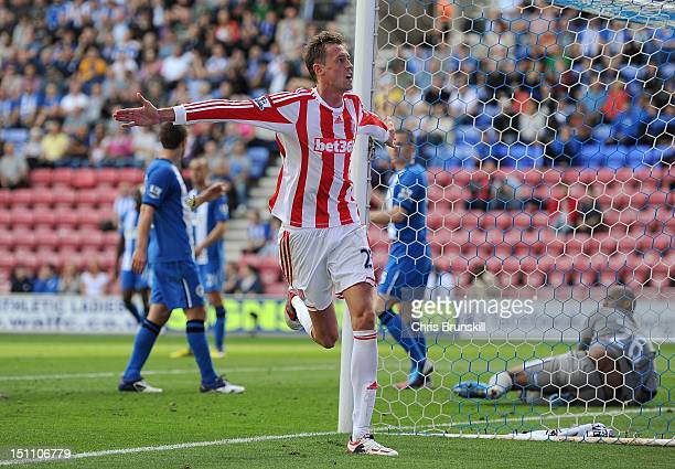 Peter Crouch of Stoke City celebrates scoring his side's second goal during the Barclays Premier League match between Wigan Athletic and Stoke City...