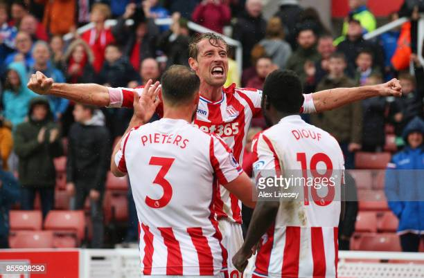 Peter Crouch of Stoke City celebrates scoring his sides second goal with his team mates Erik Pieters and Mame Biram Diouf during the Premier League...