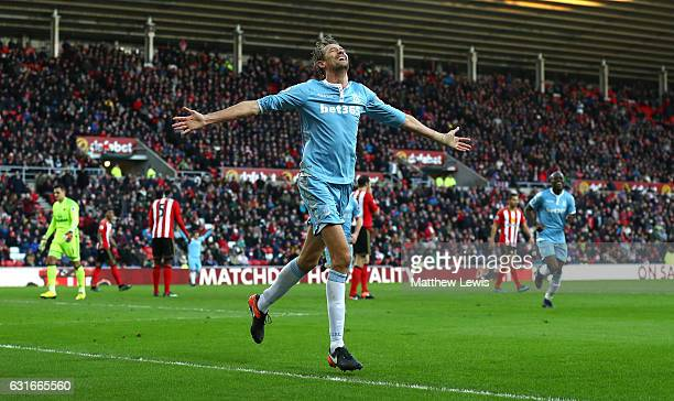 Peter Crouch of Stoke City celebrates scoring his sides third goal during the Premier League match between Sunderland and Stoke City at Stadium of...