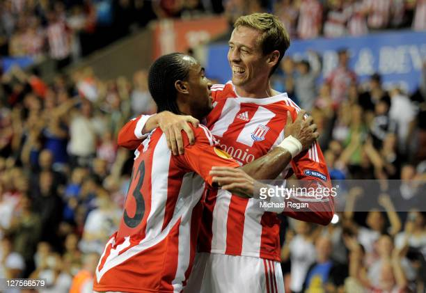 Peter Crouch of Stoke City celebrates scoring his team's first goal with team mate Cameron Jerome during the UEFA Europa League Group E match between...