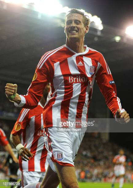 Peter Crouch of Stoke City celebrates scoring his team's first goal during the UEFA Europa League Group E match between Stoke City and Besiktas JK at...