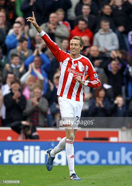 Peter Crouch of Stoke City celebrates scoring his team's second goal during the Barclays Premier League match between Stoke City and Wolverhampton...