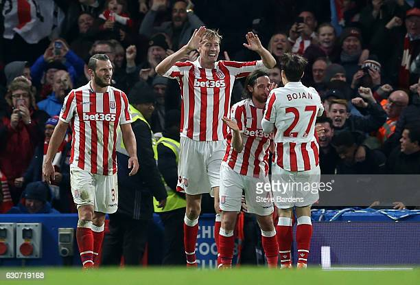 Peter Crouch of Stoke City celebrates scoring his team's second goal with his team mates during the Premier League match between Chelsea and Stoke...