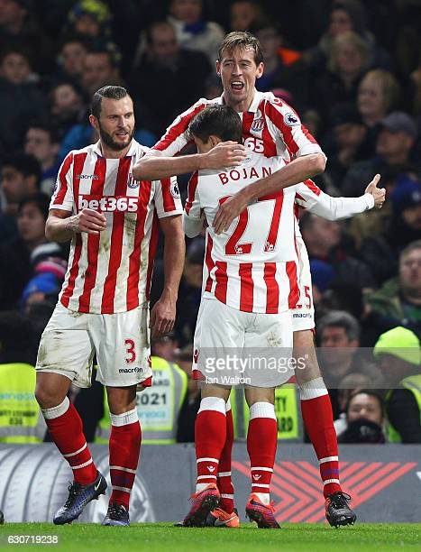 Peter Crouch of Stoke City celebrates scoring his team's second goal with his team mates Bojan Krkic and Erik Pieters during the Premier League match...