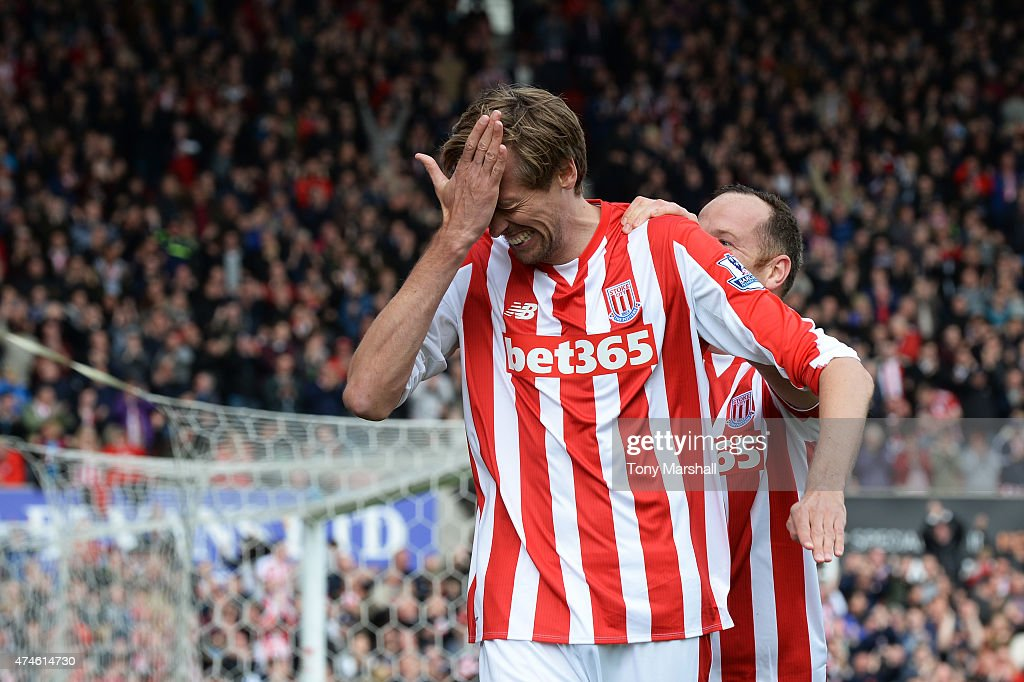 Peter Crouch of Stoke City celebrates scoring his team's sixth goal wduring the Barclays Premier League match between Stoke City and Liverpool at Britannia Stadium on May 24, 2015 in Stoke on Trent, England.