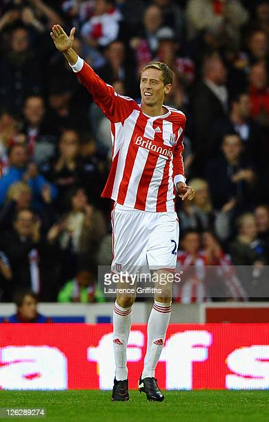 Peter Crouch of Stoke City celebrates scoring the equalising goal during the Barclays Premier League match between Stoke City and Manchester United...