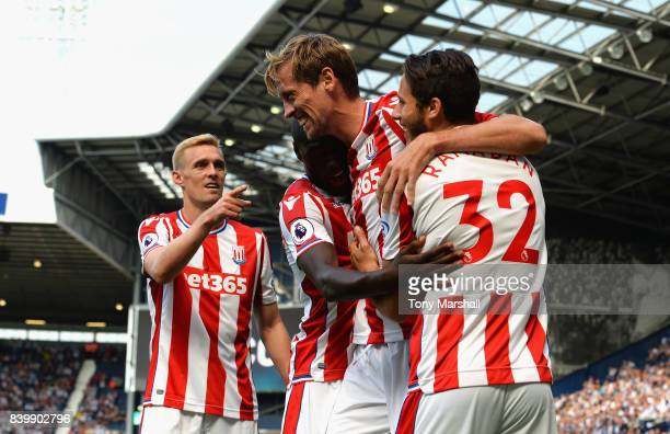 Peter Crouch of Stoke City celebrates scoring the equalising goal during the Premier League match between West Bromwich Albion and Stoke City at The...