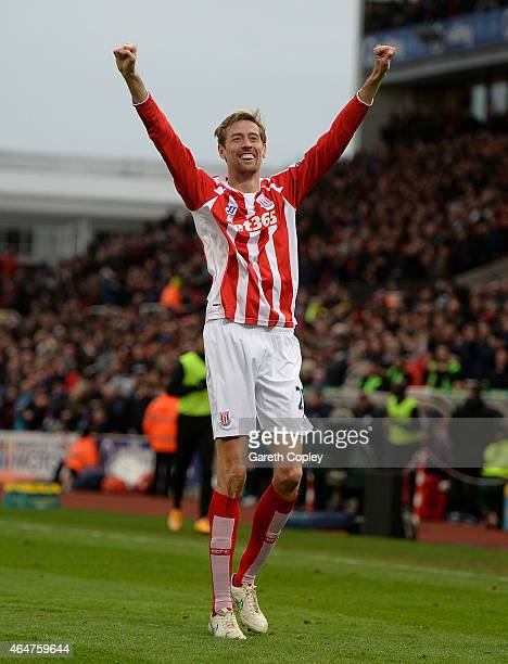 Peter Crouch of Stoke City celebrates scoring the first goal during the Barclays Premier League match between Stoke City and Hull City at Britannia...