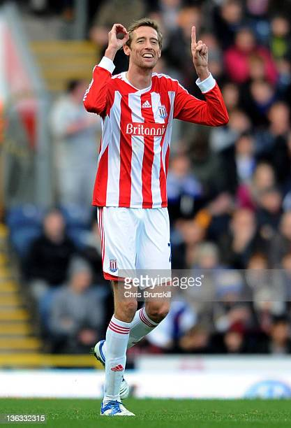 Peter Crouch of Stoke City celebrates scoring the opening goal during the Barclays Premier League match between Blackburn Rovers and Stoke City at...