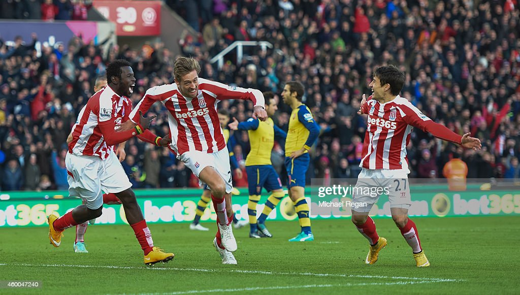 Peter Crouch of Stoke City celebrates scoring the opening goal during the Barclays Premier League match between Stoke City and Arsenal at the Britannia Stadium on December 6, 2014 in Stoke on Trent, England.