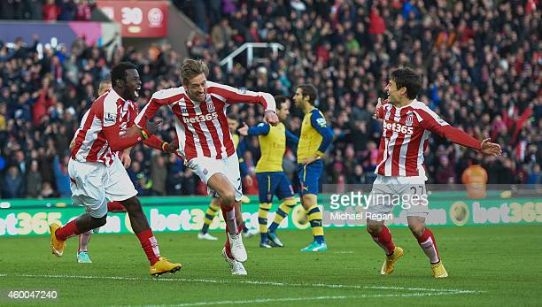 Peter Crouch of Stoke City celebrates scoring the opening goal during the Barclays Premier League match between Stoke City and Arsenal at the...