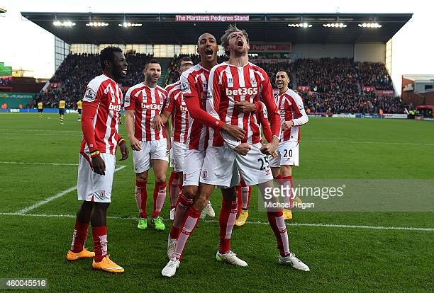 Peter Crouch of Stoke City celebrates scoring the opening goal with his team-mates during the Barclays Premier League match between Stoke City and...