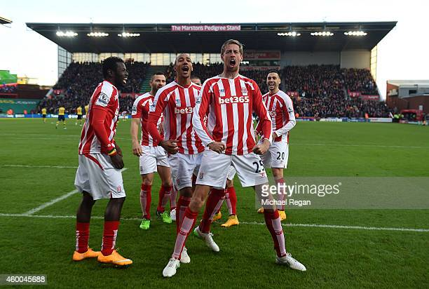 Peter Crouch of Stoke City celebrates scoring the opening goal with his teammates during the Barclays Premier League match between Stoke City and...