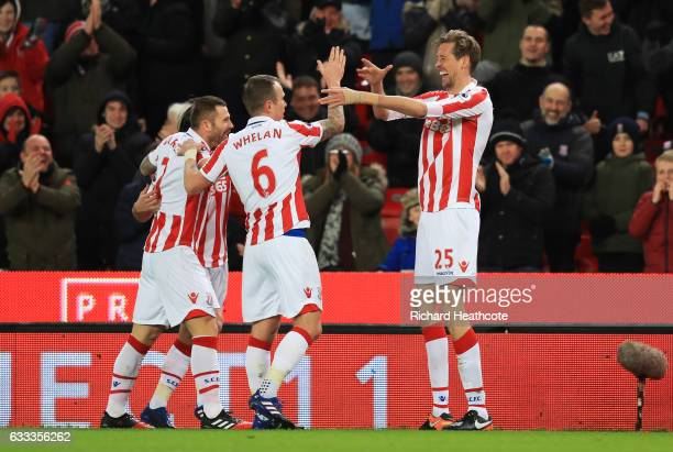 Peter Crouch of Stoke City celebrates scoring the opening goal with team mates during the Premier League match between Stoke City and Everton at...