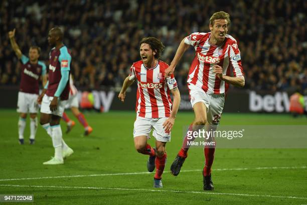 Peter Crouch of Stoke City celebrates with team mate Joe Allen of Stoke City after scoring his sides first goal during the Premier League match...