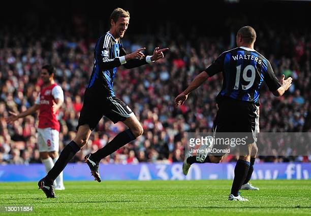 Peter Crouch of Stoke City celebrates with team mate Jonathan Walters of Stoke City after scoring during the Barclays Premier League match between...