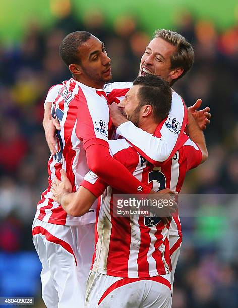 Peter Crouch of Stoke City celebrates with team mates Steven N'Zonzi and Erik Pieters as he scores their first goal during the Barclays Premier...